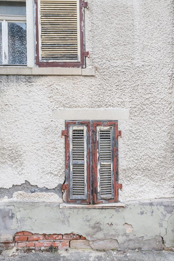 Old window with closed wooden shutters, Germany.  royalty free stock photo