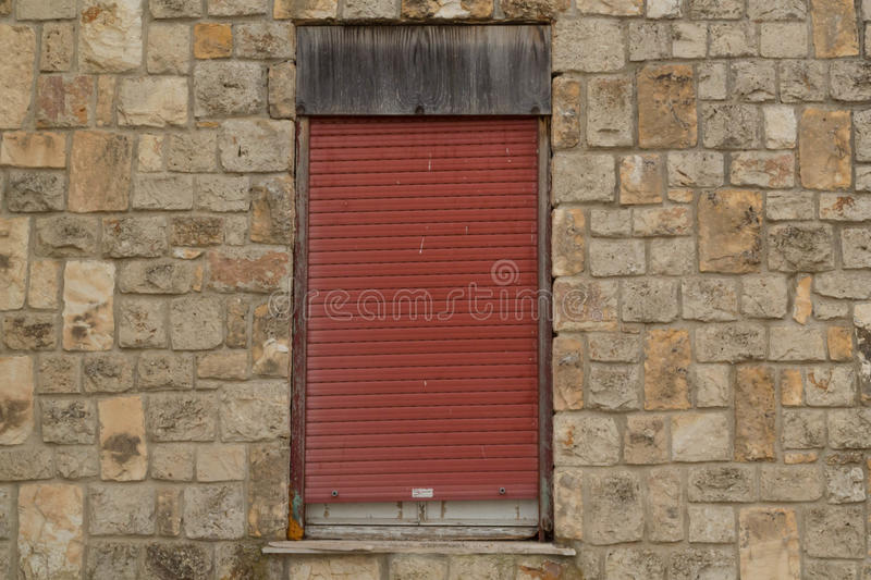 Old window. In colored plastic faded stock image