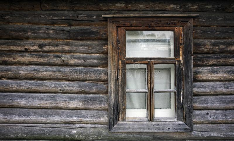 Old window in a country house. The texture of the logs. Rustic background stock photos