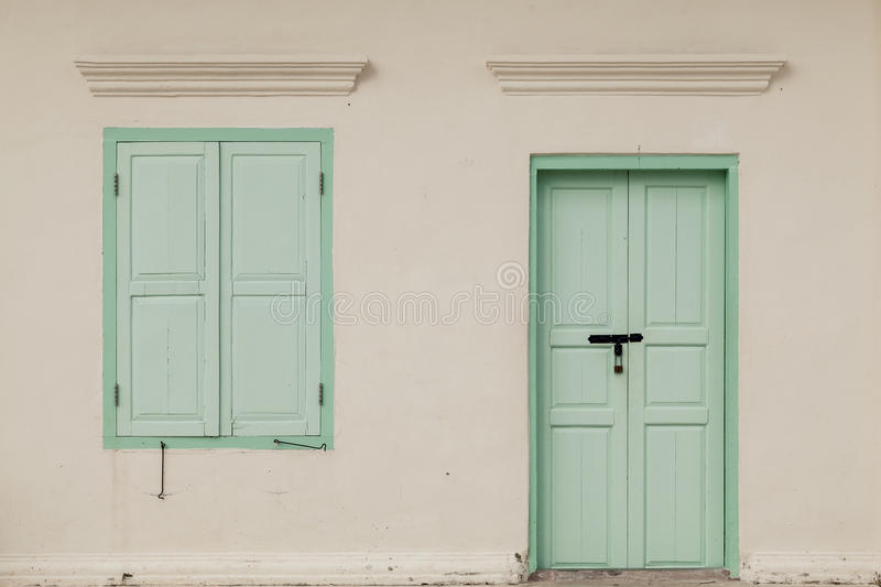 Old window and door on color wall thai style, vintage tone class. Ic royalty free stock photo