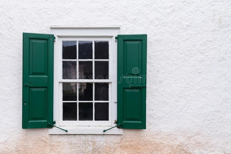 Old Window with Green Shutters. On a White Wall royalty free stock photos