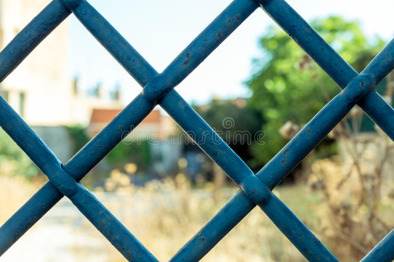 Old Window Iron Bars. Old rusty iron bars that are part of a deserted, broken house royalty free stock photo