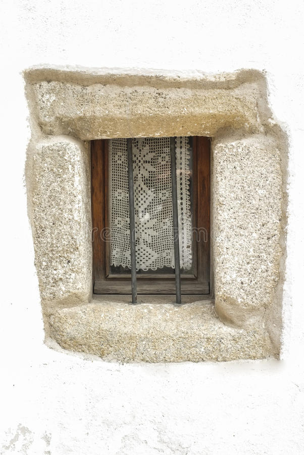 Old window with knitting courtain, at downtown street. Trujillo, Spain royalty free stock images