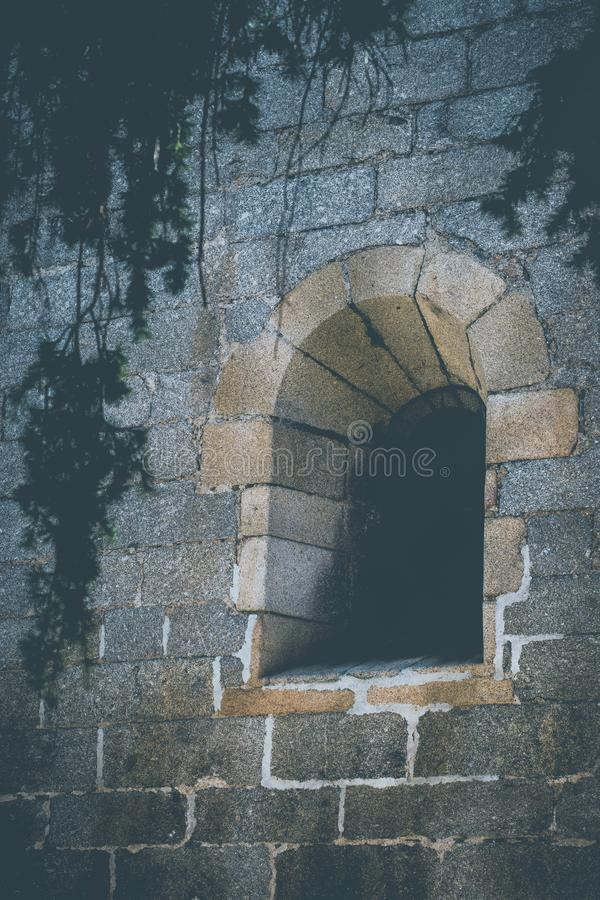Old window, made of stone, from ancient church. Landscape of old window, made of stone, from ancient church stock images