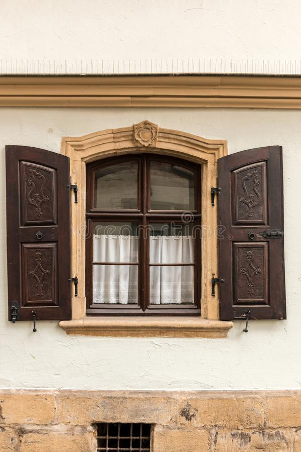 Old window made of stone and wood with brown shutters stock photos