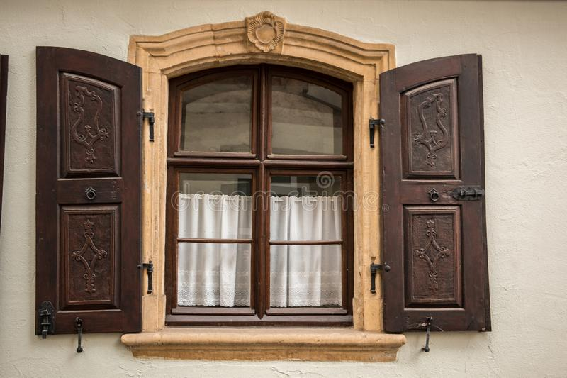 Old window made of stone and wood with brown shutters royalty free stock image