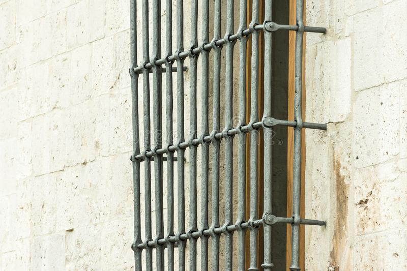 Old window with metal bars in stone building royalty free stock image