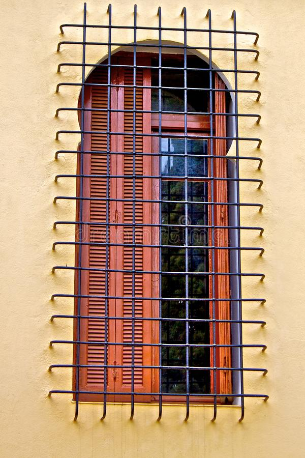 Old window with metal grid royalty free stock photos