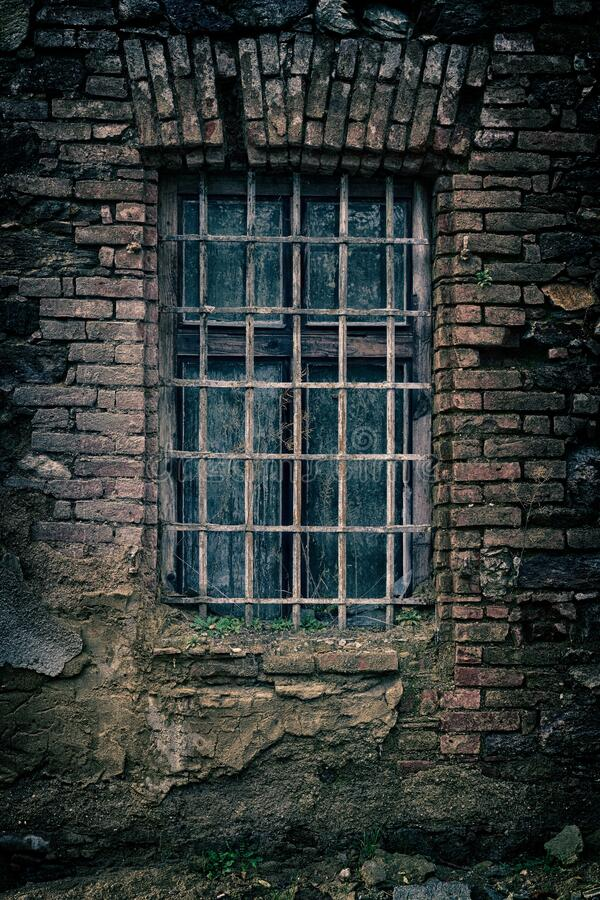 Old window with metal grids royalty free stock photos