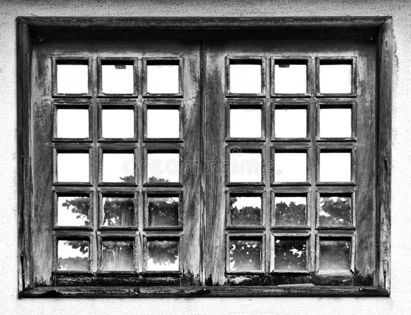 An old window with reflexes stock image