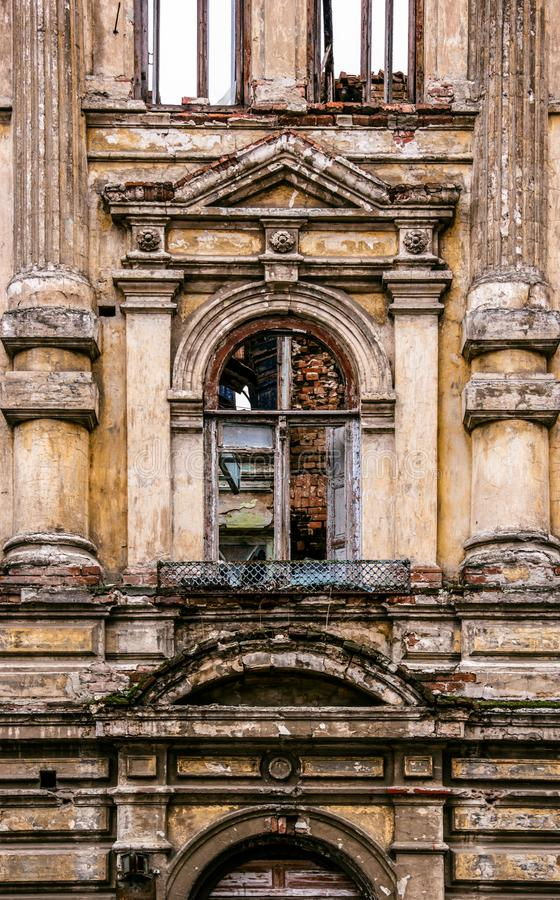 An old window in ruined mansion. Facade of the old burnt house stock images
