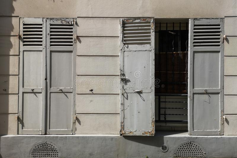 Old window shutter, open and closed shutters, old europe concept. Retro paris royalty free stock image