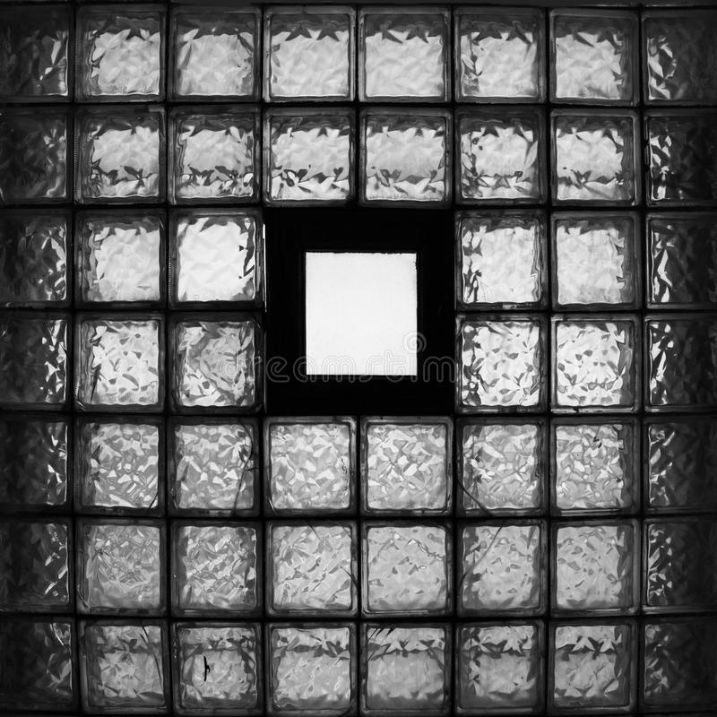 Old window of small tiled glasses with empty place in center stock photo