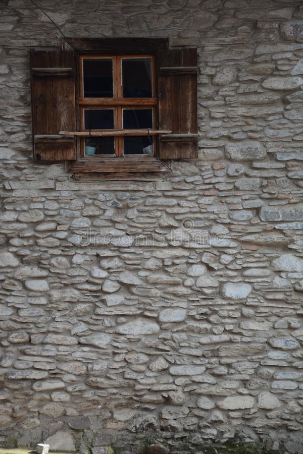 Old window in stone wall. Old wooden window old window in stone wall royalty free stock images