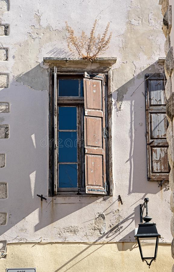 Street detail of Rethymno old town, Crete island, Greece. Old window, a street detail of Rethymno old town, Crete island, Greece royalty free stock image