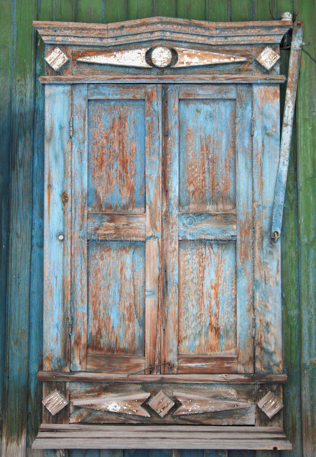 Free Old Window With Cracked Decorative Frame And Storm Shutters Closed. Stock Photos - 72365053