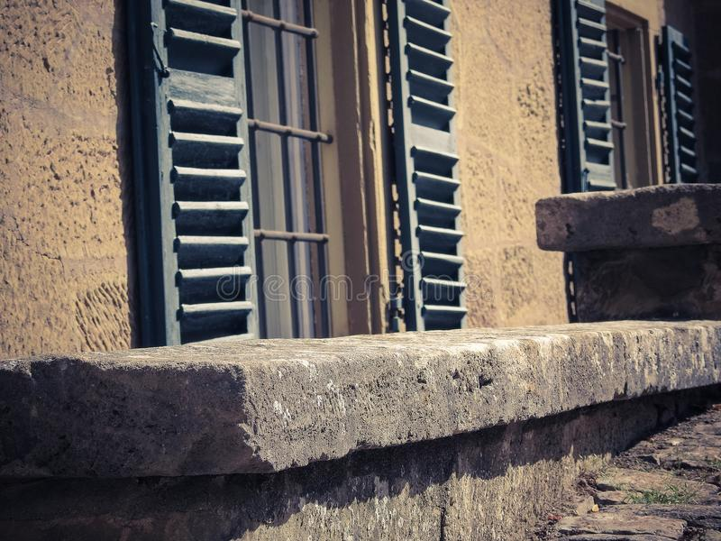 Old window with wooden shutters. And metal grid stock images
