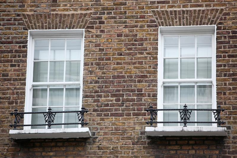 Old windows. Two Old windows in London royalty free stock photography