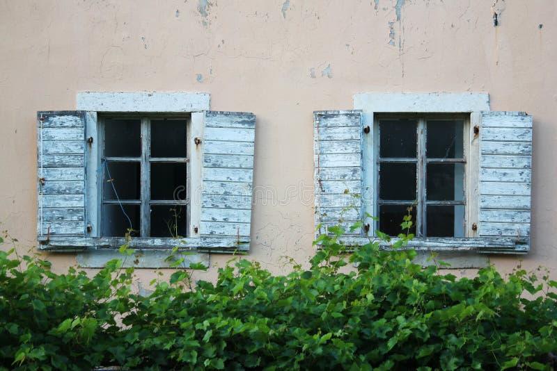 Old windows in Budva, Montenegro stock images