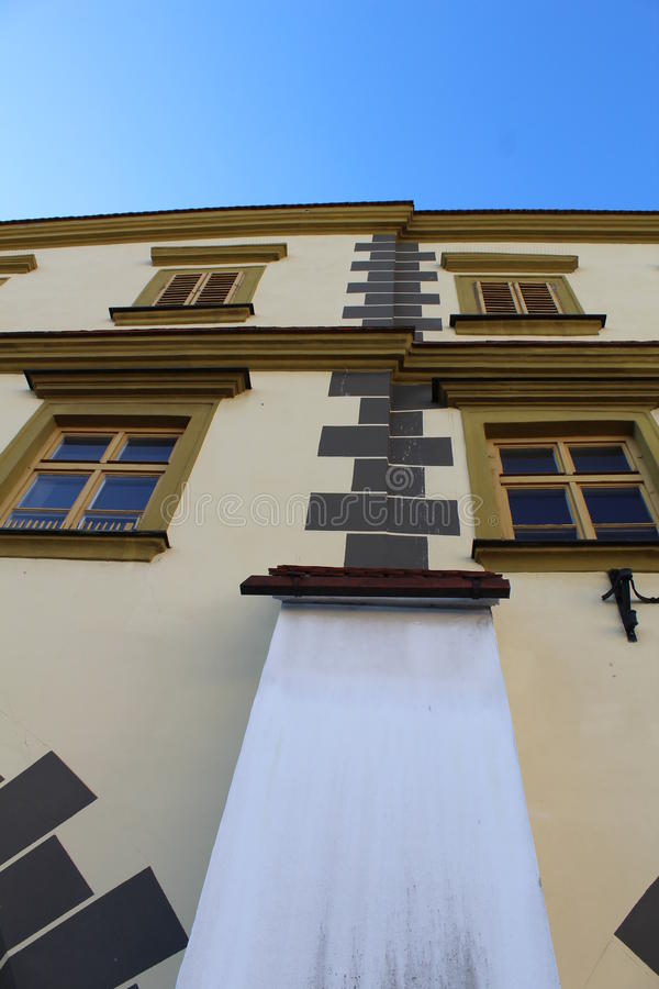 Old windows. Old townhouse located on the square in Kroměříž. Wooden windows of the old house are very strong. They have bright colors and are made stock photography