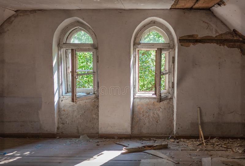 Old windows. White lit vintage, old window in an ancient white brick wall in an abandoned castle, interior with light from the windows, old windows with empty stock image