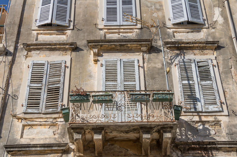 Old windows with wood jalousie and flowers stock photography