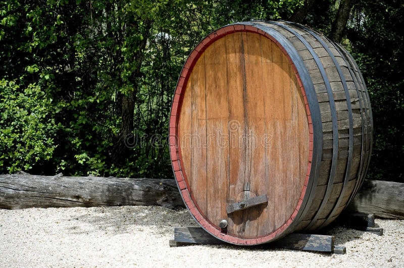 Old wine barrel. Very old large wine barrel, oval shaped, about six feet tall stock photos