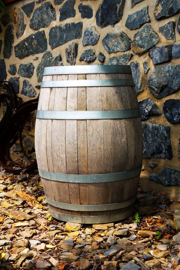 Old wine barrel. Wooden wine barrel, wine barrel located in the garden, wine barrel located in the vineyard royalty free stock image