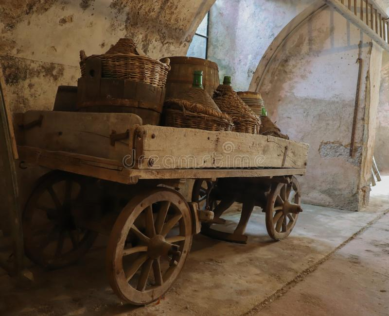 Old wine cart in Milan, Italy. Wine cart in a old winery in Milan, Italy. There are some three bottles stock photos