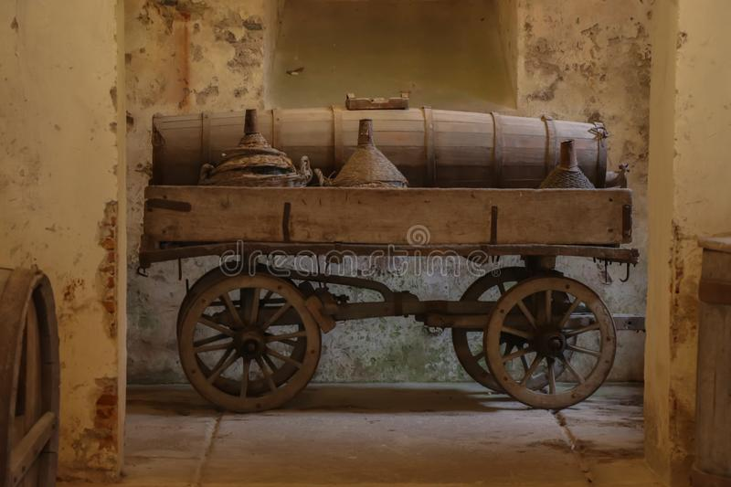 Old wine cart in Milan, Italy. Wooden wine cart in a old winery in Milan, Italy royalty free stock photography