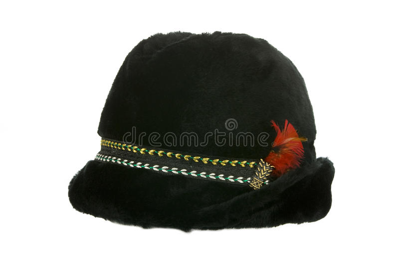 Old winter furry black hat. Isolated on white side view stock photo