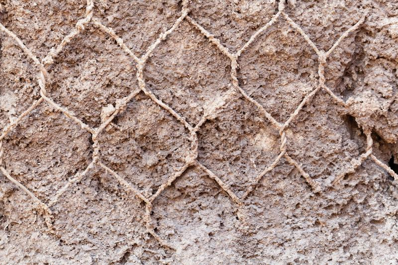 Old wire netting in concrete stock photography