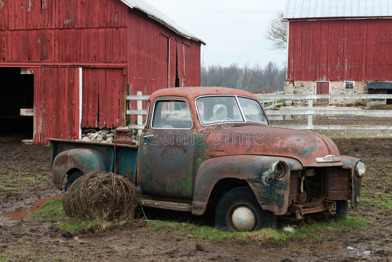 Old Wisconsin Dairy Farm Truck. An old classic rusty pickup truck sits on a Wisconsin dairy farm stock image