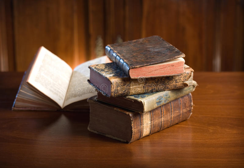 Old wisdom. Beautiful antique books in very elegant setting stock photography