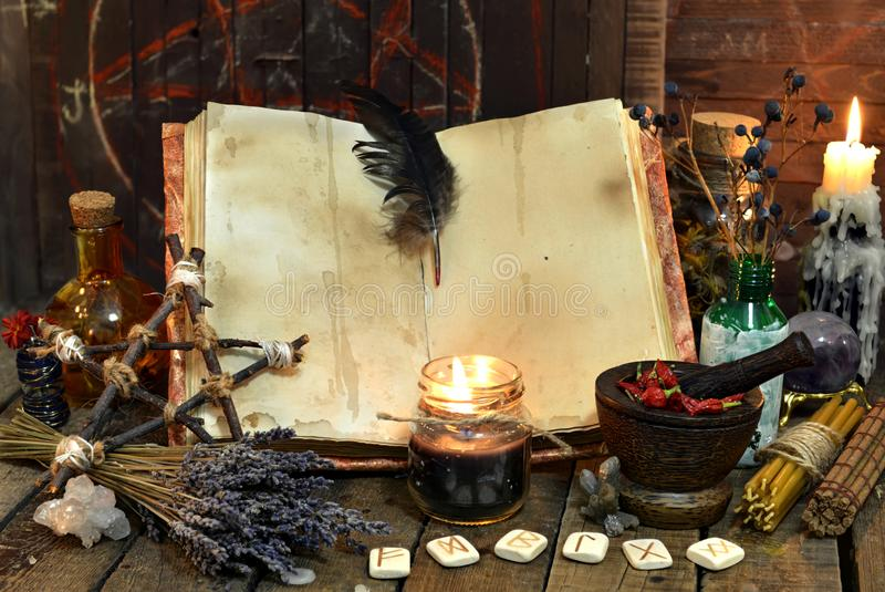 Old witch book with empty pages, lavender flowers, pentagram and witchcraft objects stock photos