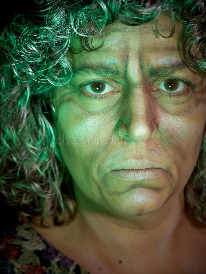 Old Witch in Green Light stock photos