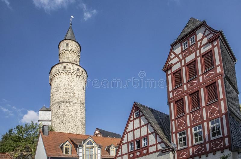 Old witch tower in Idstein and facade of half timbered house. Germany from medieval times stock image