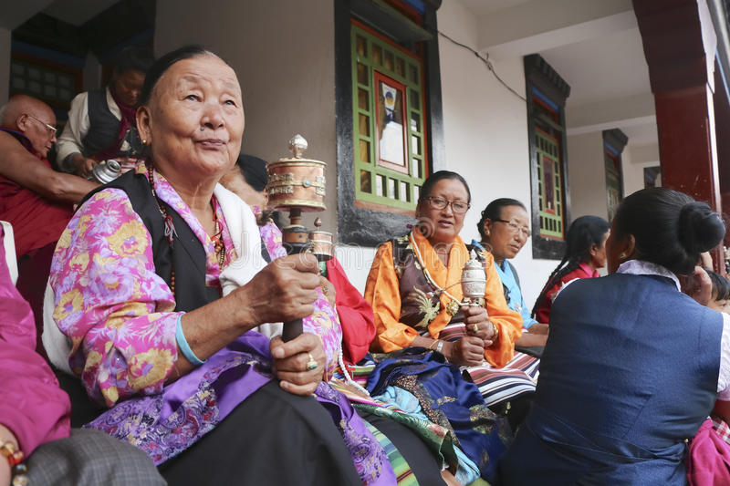 Old woman at a buddhist monastery royalty free stock photo
