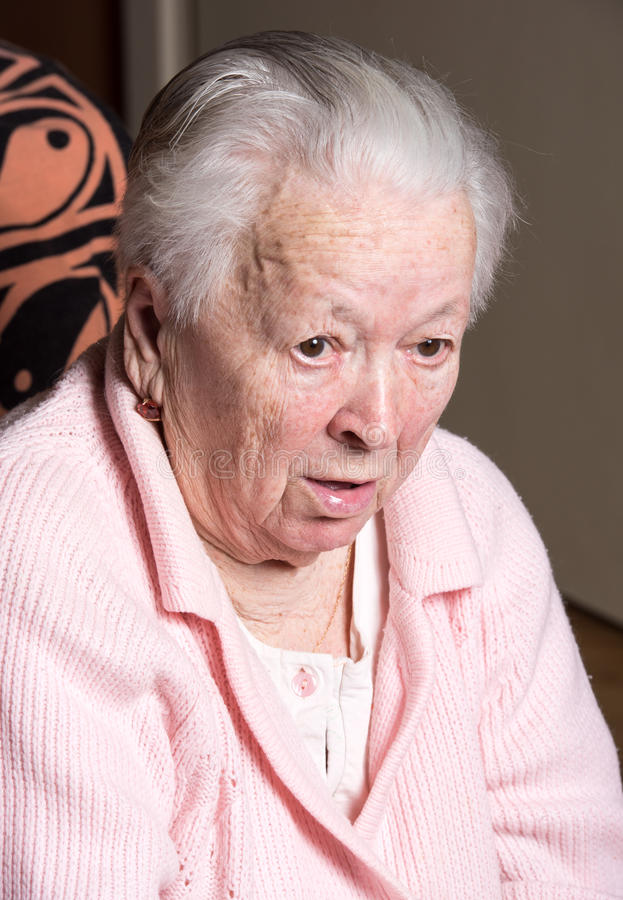 Old woman coughing. At home stock photo
