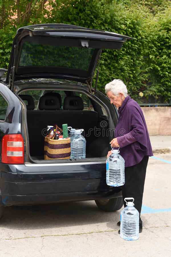 Old Woman Downloading The Car Stock Photo - Image of bags, happy ...