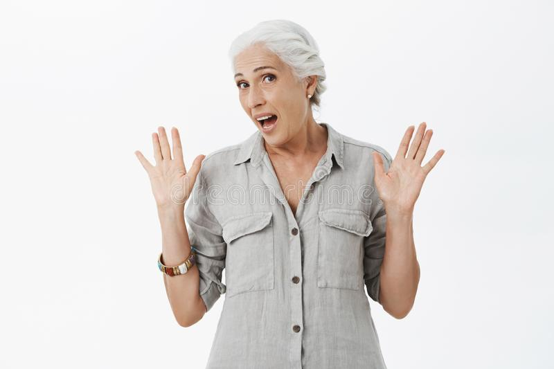 Old woman feleing tired not wanting participate in event. Portrait of uninterested and uninvolved cute granny with white royalty free stock photo