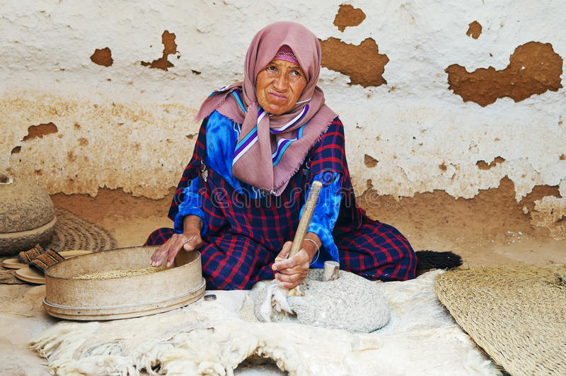 Download Old woman grinds grains editorial photography. Image of people - 22765047