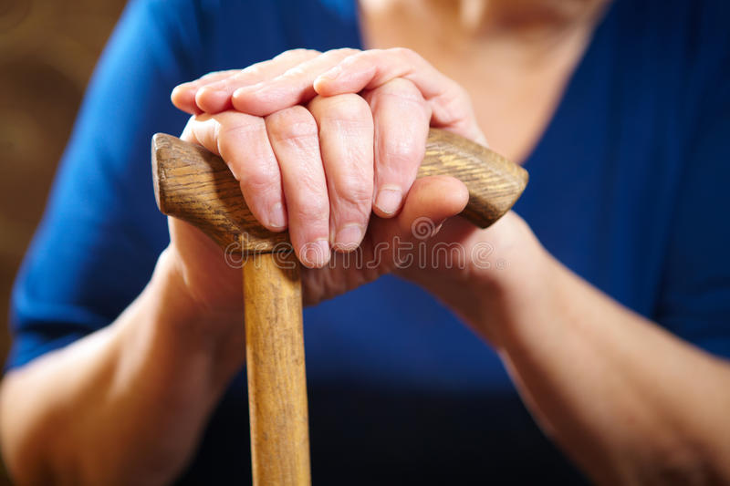 Old woman hands with cane. Senior people health care royalty free stock photography