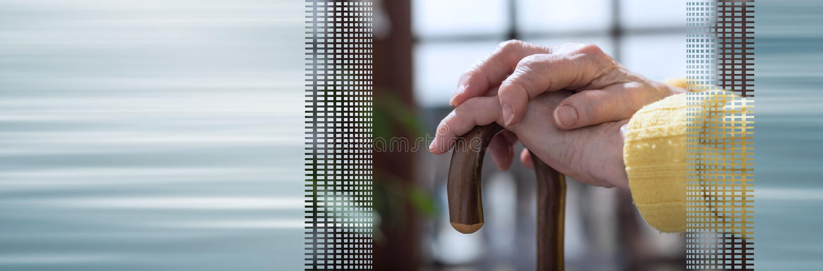 Old woman hands holding a cane. panoramic banner. Old woman hands holding a walking cane. panoramic banner royalty free stock images