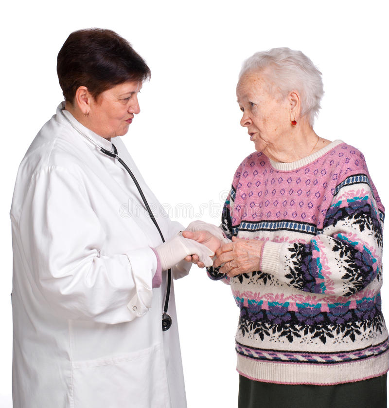 Old woman having discussion with her doctor royalty free stock photo
