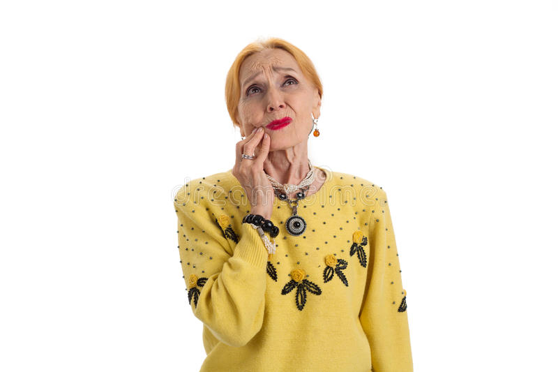 Old woman having toothache. Upset lady looking up isolated. Pain caused by gum disease stock photo