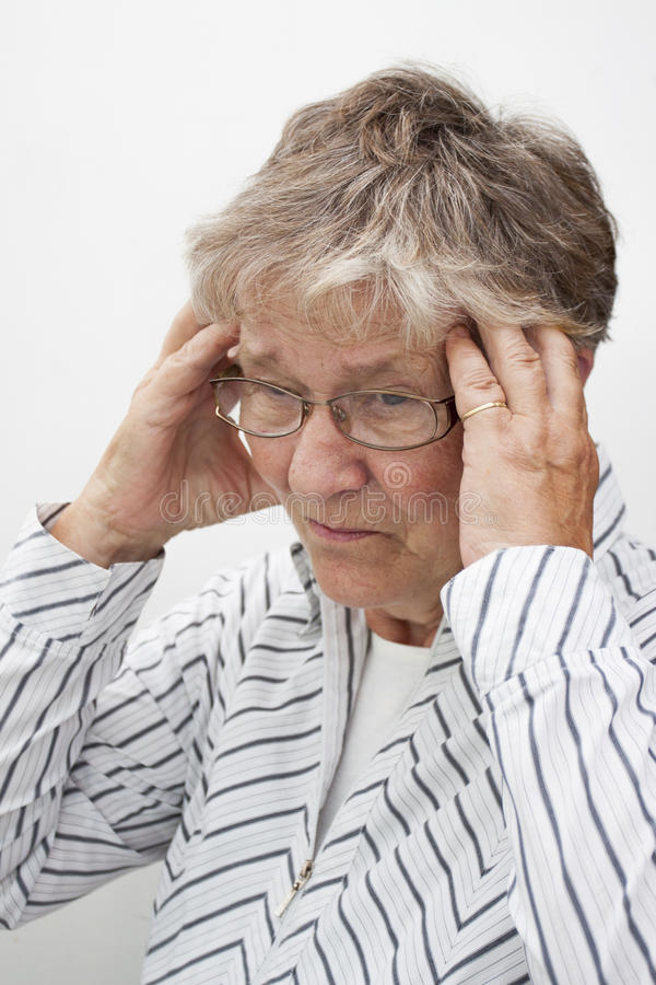 Old woman with head ache royalty free stock image