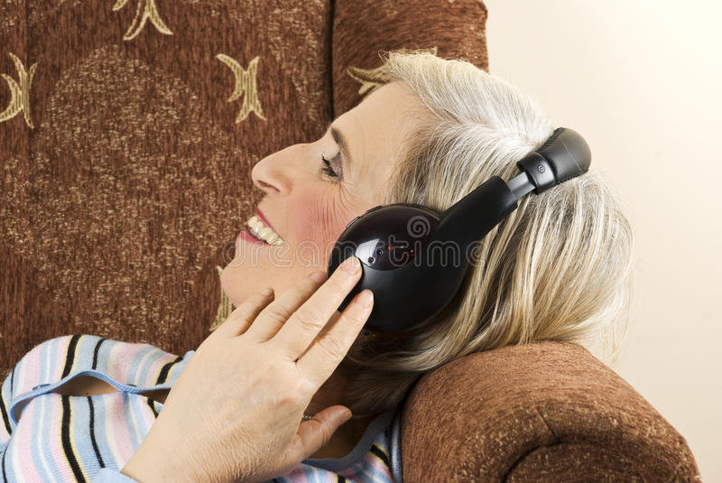 Download Old Woman With Headphones In Sofa Stock Image - Image: 12200709