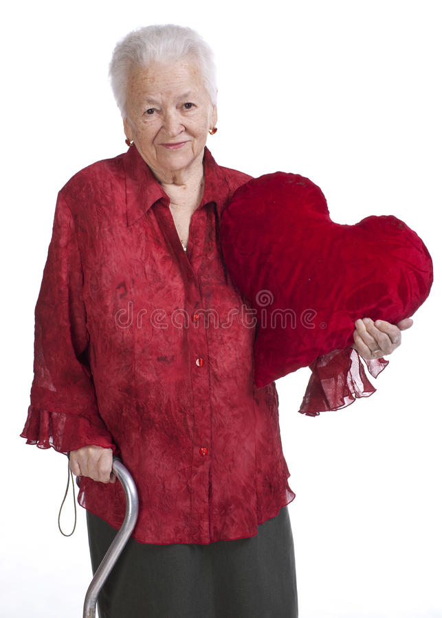 Old woman with a heart pillow