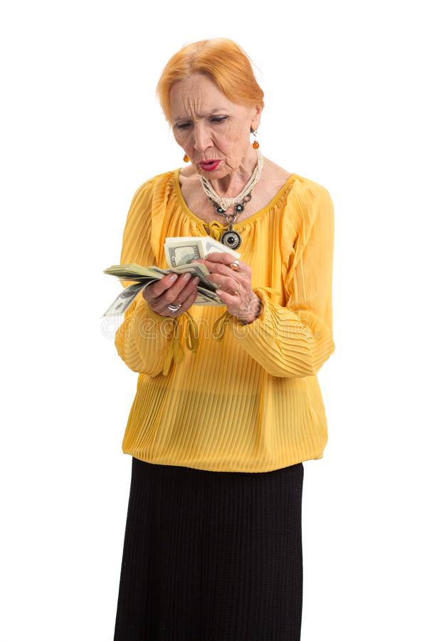 Old woman holding money isolated. stock image